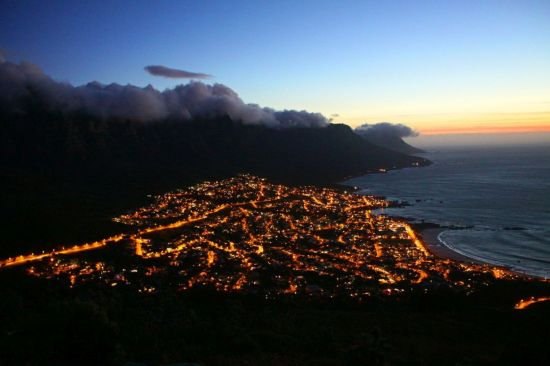 The village of Camps Bay at night from Lion's Head